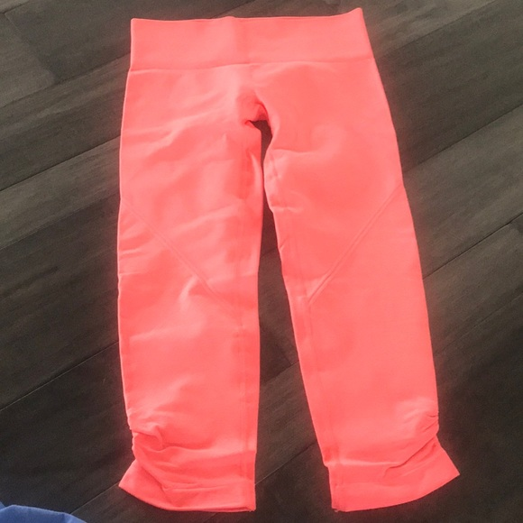 lululemon athletica Pants - Lululemon light neon tangerine cropped yoga pants
